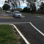 another motorist goes over the island at the Junction Road and Georges River Road roundabout
