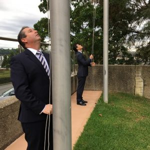 Our hard working MPs show off flag raising skills