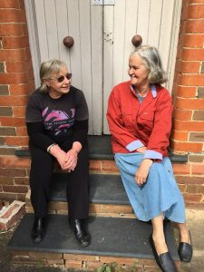 Laurie Porter and Joan Cootes on the steps of the old St James Anglican Church at Minto