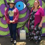 Meg Oates with artist Jessica Fesic and her pedestrian underpass mural.
