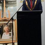 portrait of Queen Elizabeth II is just off the ground