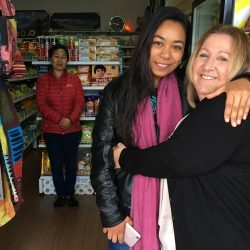 OCAGI founder Polly Grundy with medical researcher Prapti Shestra and her mother Bina in the family's Himalayan store in Ingleburn.