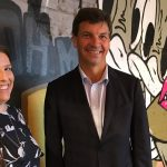 Sydneysider's general manager Kaitlyn and MP Angus Taylor in front of a Melbourne cafe laneways inspired wall inside the new restaurant in Camden.