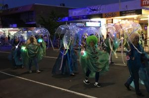 The annual festival parade brings residents to the main street once a year
