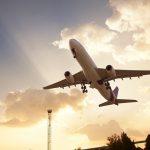 Jet Airplane take off at sunset