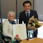 MP Anoulack Chanthivong presents a NSW Government community service award to Minto resident Laurie Porter.
