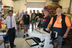 MP Anoulack Chanthivong at the Macquarie Fields men's shed, which received funding under the community building partnership program