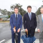 Mayor George Brticevic with Angus Taylor and Paul Fletcher on Badgally Road, which will benefit from the money saved on the Eagle Vale Road upgrade.