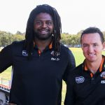 Jamal Idris with coach Jason Taylor