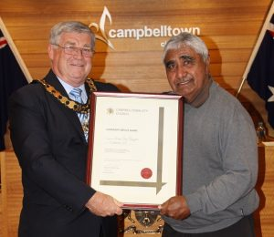Uncle Ivan Wellington receiving a community service award from Mayor Paul Lake in 2015.