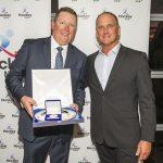 Wayne Southwell receiving the 2016 Hockey NSW Coach of the Year award from former World Hockey Player of the Year, Warren Birmingham.