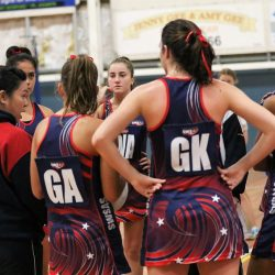 SWSAS head netball coach Van Nguyen offering her players half time instructions during a recent game.