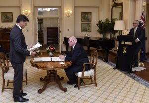 Mr Taylor being sworn in as minister last December.