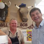 Angus Taylor with Mt Annan Quality Butchers owner Robert Mills, left, who supports lower company taxes.