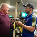 Ray Corkery presents victorious Campbelltown City captain Kurt Austin with the Corkery-Andrews Cup on Saturday night