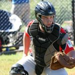 Softball catcher Corey Gleason, in action from the weekend, is one of the South West Sydney Academy of Sport athletes who will benefit from the ClubsNSW education funding.
