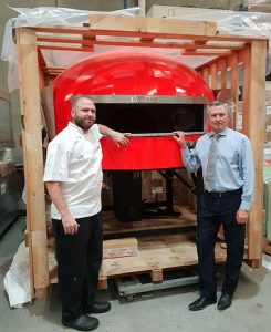 Luke Risby, Head Chef of Country Club Gledswood Hills with Wests Group Macarthur CEO Tony Mathew during delivery of the giant wood fired pizza oven.