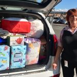 Catherine Chopping from Macarthur Homelessness Steering Committee collects some of the donated items at the halfway point of the drive for household items.