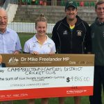 Dr Freelander presents a $4,685 to Ghosts cricket club