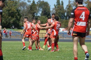 The Eagles celebrate their win on Saturday, which has put them in the 2014 decider against Mounties next Sunday, September 28