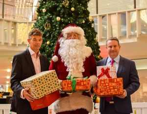 Greg Warren with Macarthur Square centre manager Trevor Hill and Santa.