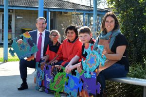 MP Greg Warren, Briar Road Public School students Tyleah Tompkins, Orlando Wright, Nathan Eberhardt and artist Danielle Mate-Sullivan.