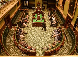 Local students have their photo taken in the NSW Legislative Assembly - also known as the bear pit,