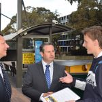 Campbelltown MP Greg Warren and Wollongong MP Paul Scully (left) talk with University of Wollongong student, Jack Taylor regarding the 887 bus service.
