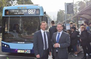The two Labor MPs with students boarding the 887 Wollongong to Campbelltown bus service last week.