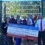 MP Greg Warren with Campbelltown Public School Principal Anna Butler and students celebrating their newly upgraded playground.