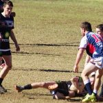 a Magpies player player is tackled by Camden in the thriller at Victoria Park won by the home side 20-14.