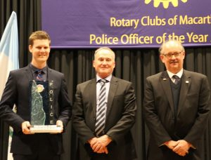 Police officer of the year Senior Constable David Blom receives his award from NSW Assistant Police Commissioner Peter Thurtell and Rotary immediate past district governor Stephen Britten
