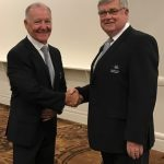 Paul Lake, right, congratulates Roy Warby for becoming the 11th life member.