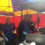 A Campbelltown Lions club crew hard at work around the barbie.