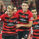 Wanderers celebrate their late, late equaliser against Melbourne City last night.