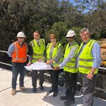 George Brticevic, second from left, next to Senator Marise Payne during an inspection of work on the new bridge at the entrance to Wedderburn