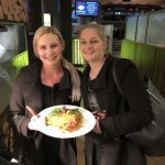 A couple of Wests members get into the spirit of the Parma for a Farmer fundraising drive.