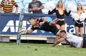 Corey Thompson scores the winning try for the Wests Tigers